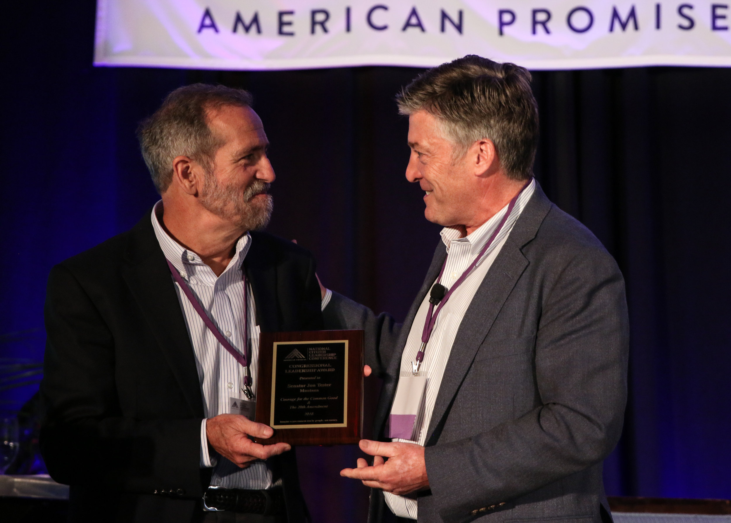 Citizen Leader, CB Pearson, accepts an award on behalf of Sen. Jon Tester