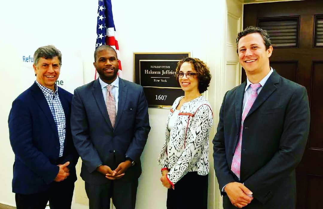 Pictured left to right: Scott Groom, a staffer for Representative Hakeem Jeffries, Jessie McDade, and Mark Goldfarb.