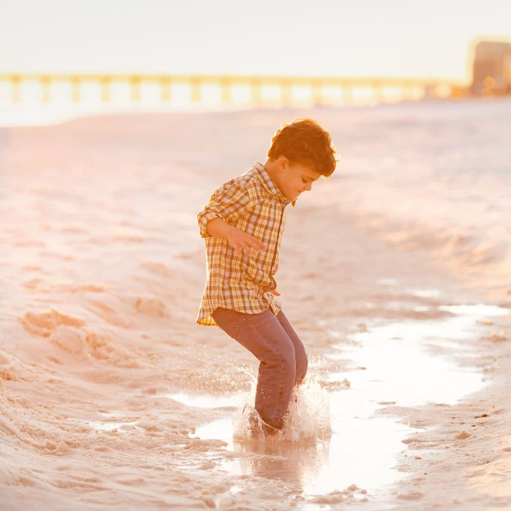 Navarre Beach portrait of boy at sunset