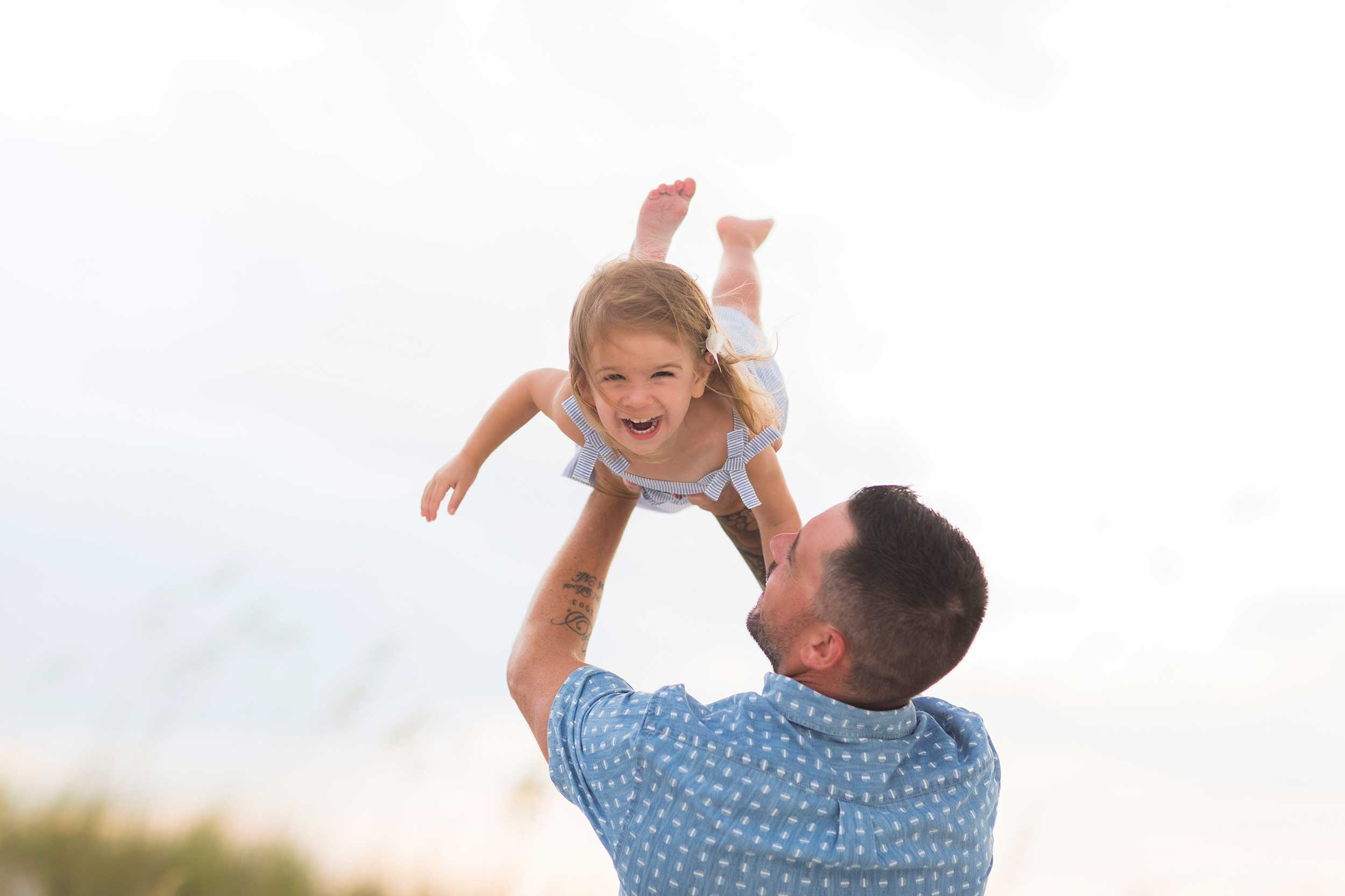 candid image of father and daughter at photo session