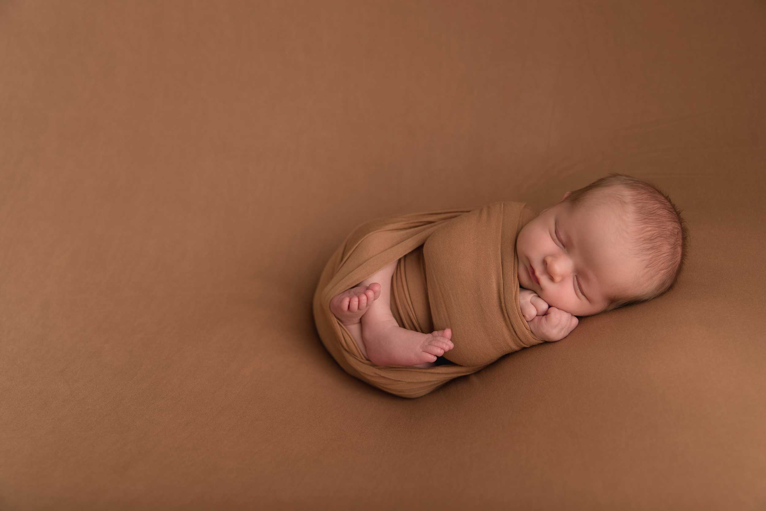 newborn photography of a small infant during mini session