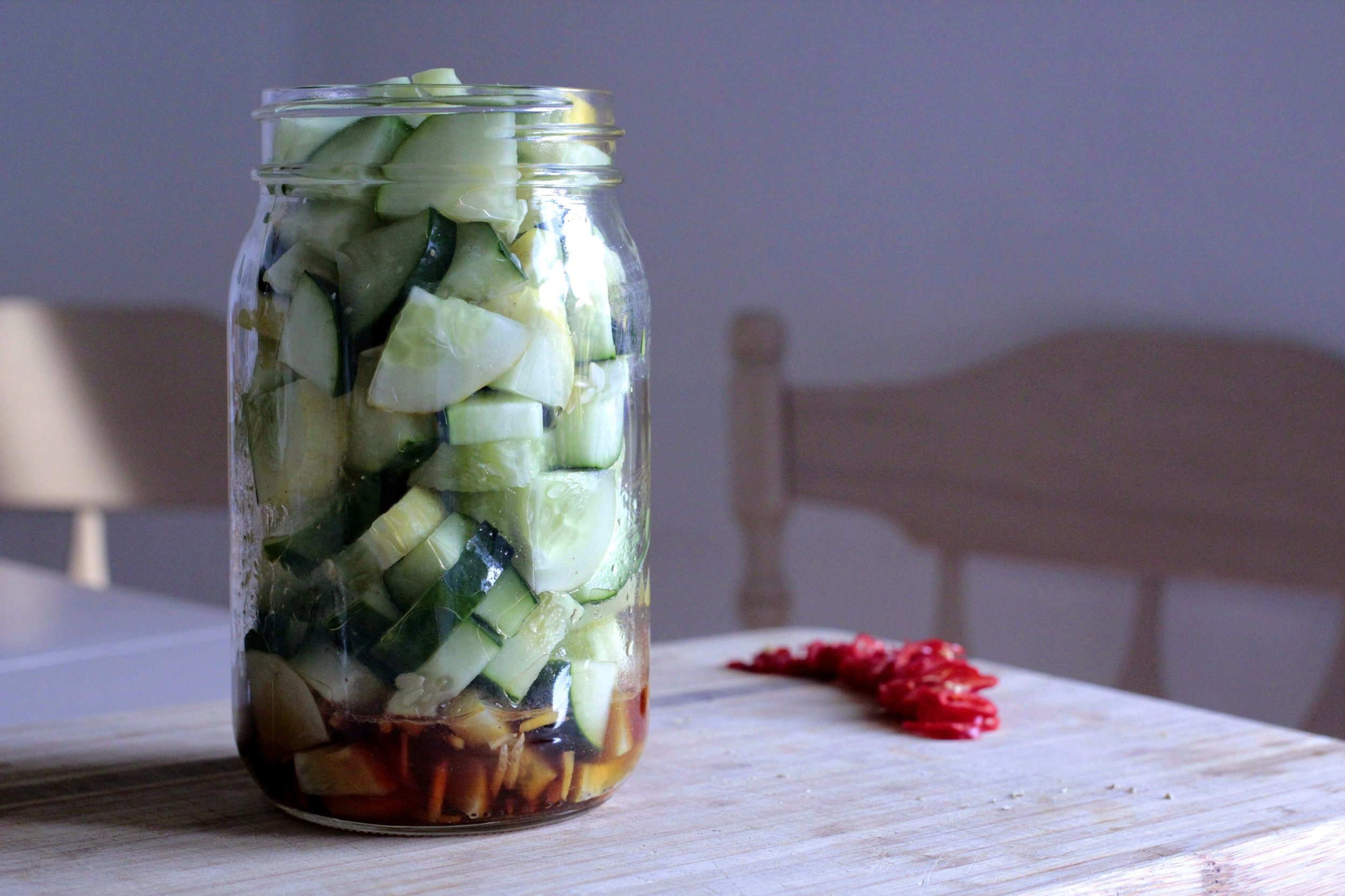 Jar. Dressing. Cucumbers.