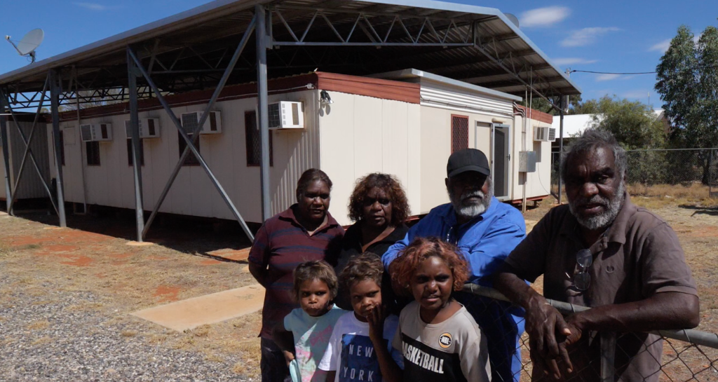 Traditional Owners and some of the young people whose lives are being changed, in front of the proposed Creative Technology Centre.