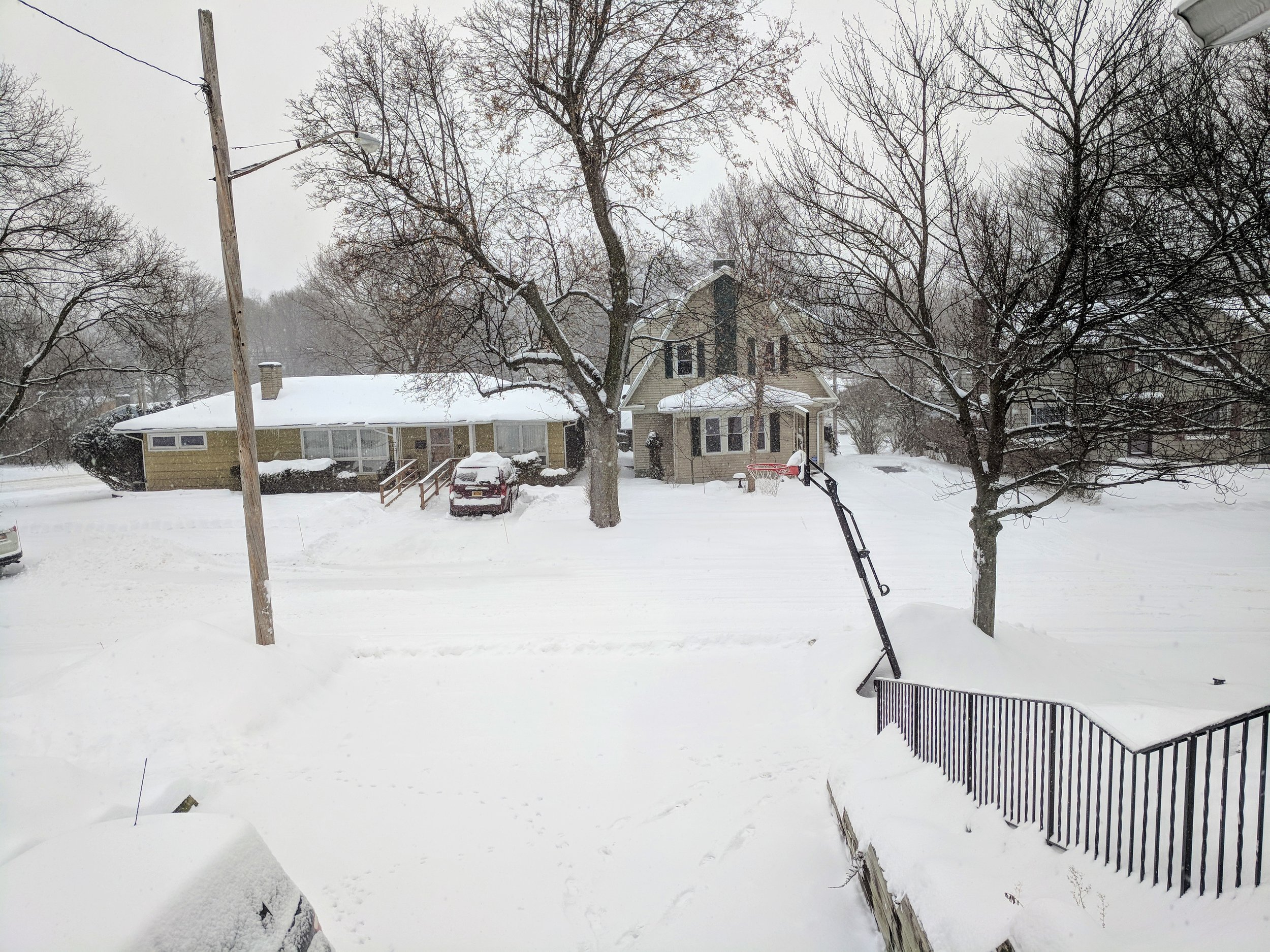 If you ever want pictures of your house, ask the neighbors across the street. The view from my window before my third shoveling of the driveway.