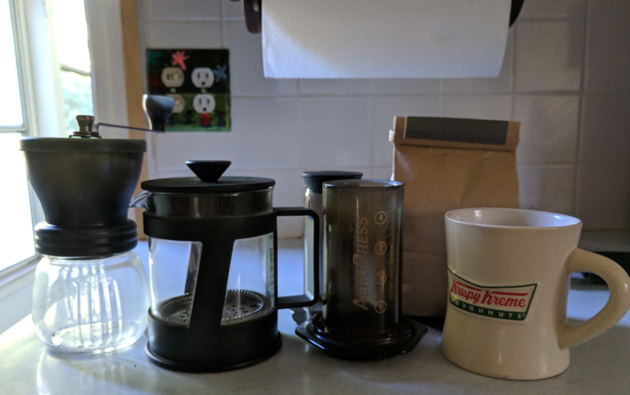 Grinder, french press, Aeropress, good beans, and a mug. Just add hot water.