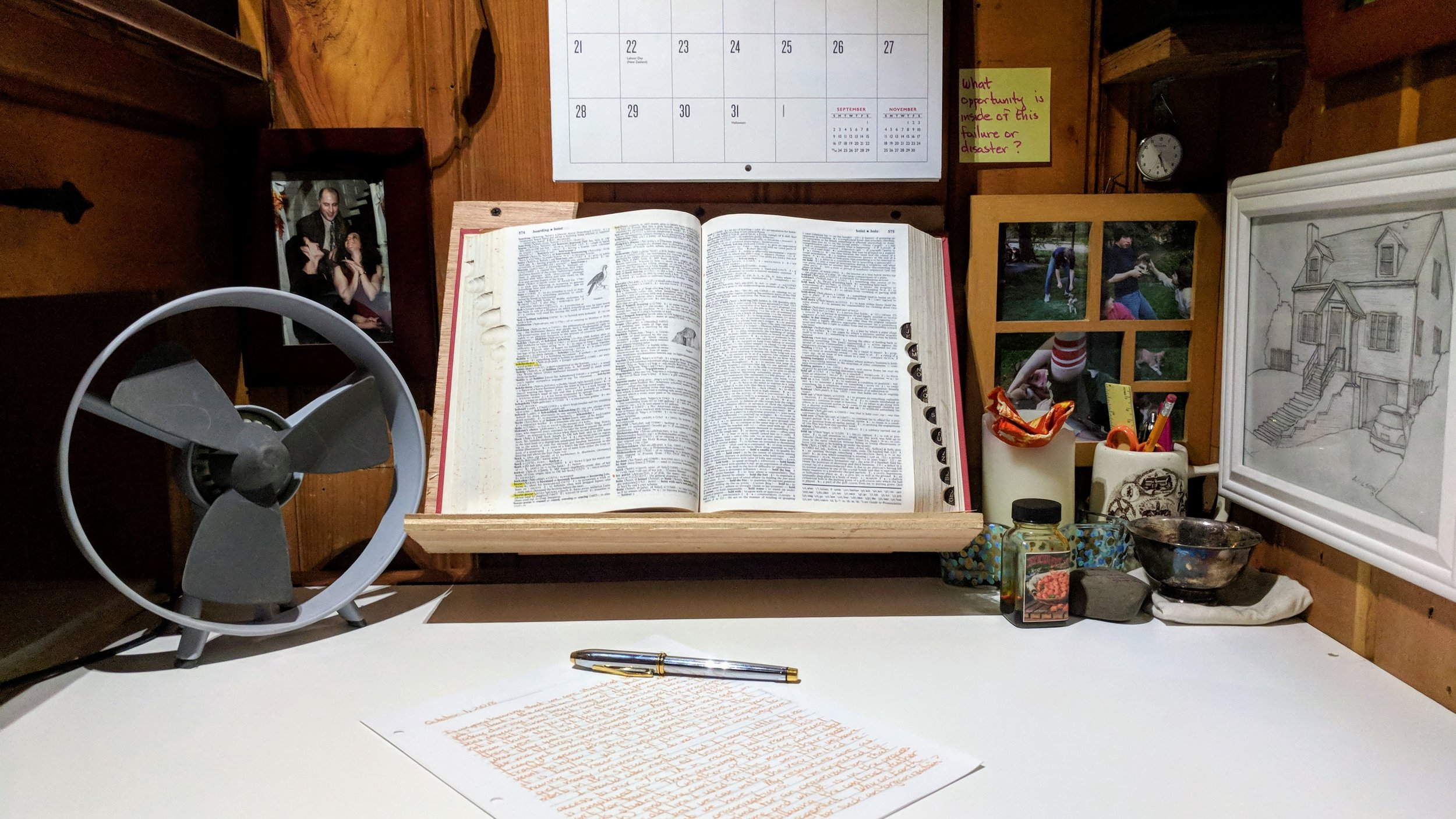 My comfy little writing nook. Dictionary front and center.
