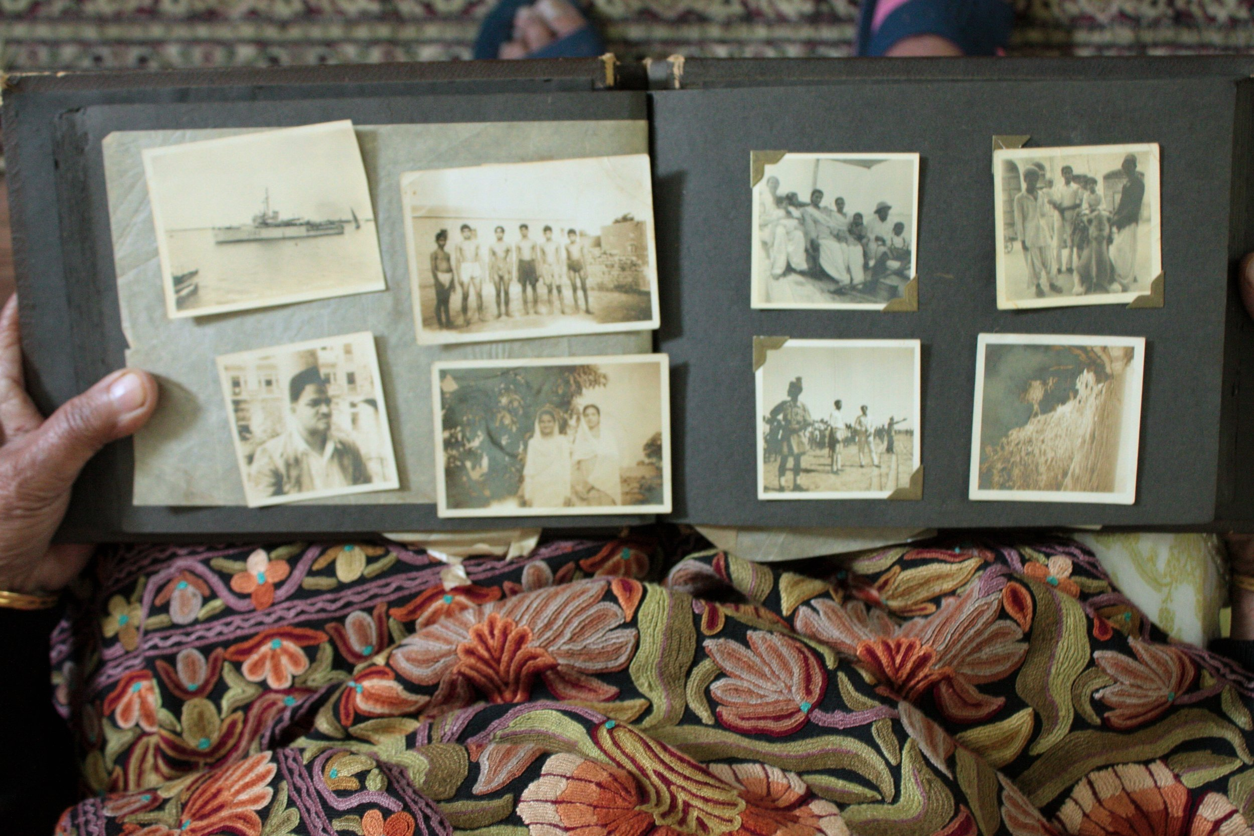A photo album showing pictures of childhood summers spent in Karachi, carried from Jhang-now in Pakistan- to Delhi- now in India- in 1947