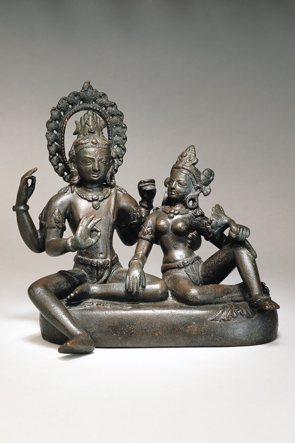 Shiva and Parvati (Uma-Maheshvara-murti) . Transitional period, late 10th–early 11th century. Nepal, Kathmandu Valley. Copper alloy. H. 6⅛ x W. 6¼ x D. 4¾ in (15.5 x 15.9 x 12 cm). Asia Society, New York: Mr. and Mrs. John D. Rockefeller 3rd Collection, 1979.48. Image courtesy Asia Society.