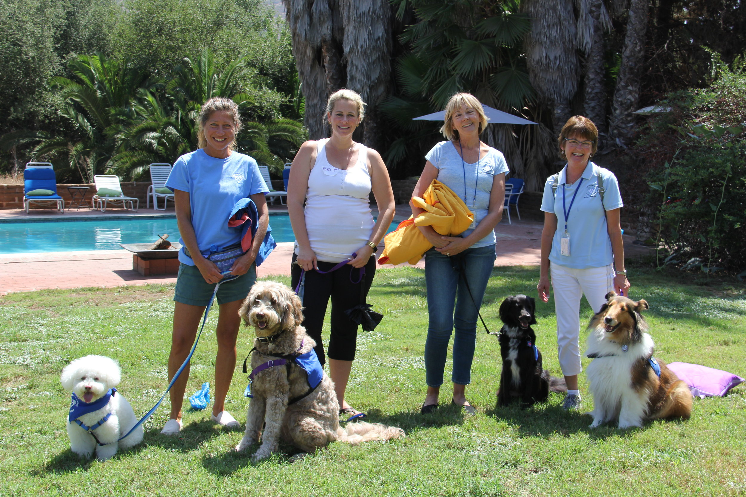 Eight months pregnant Sunlight Retreats Founder Brittany Catton Kirk with Love on a Leash Central San Diego Chapter volunteers at the August 2018 Sunlight Retreat for Survivors