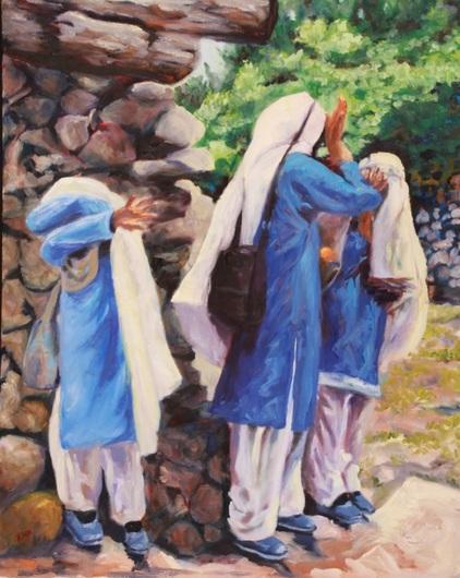 Three school girls covering their faces near the town of Shigar, Karakoram Mountain Range