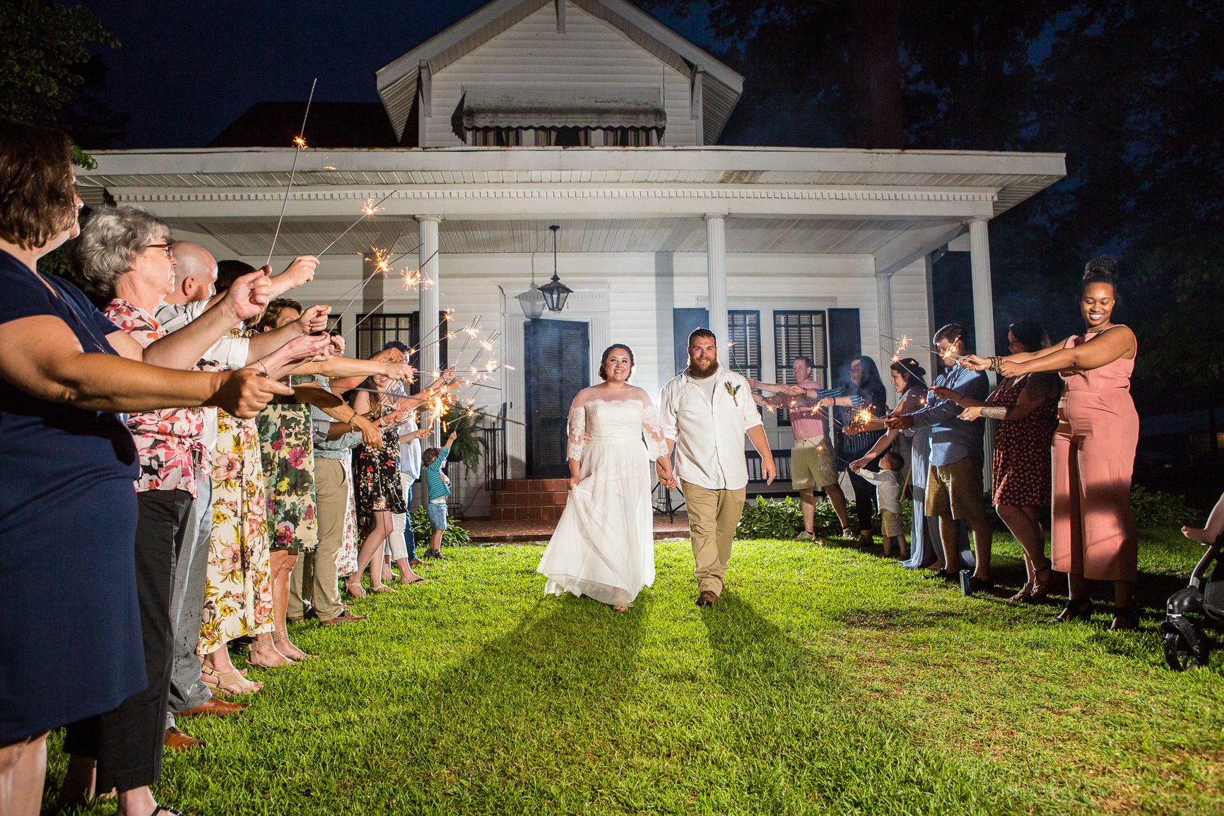101 studio llc -Raleigh bride and groom wedding exit 9.jpg