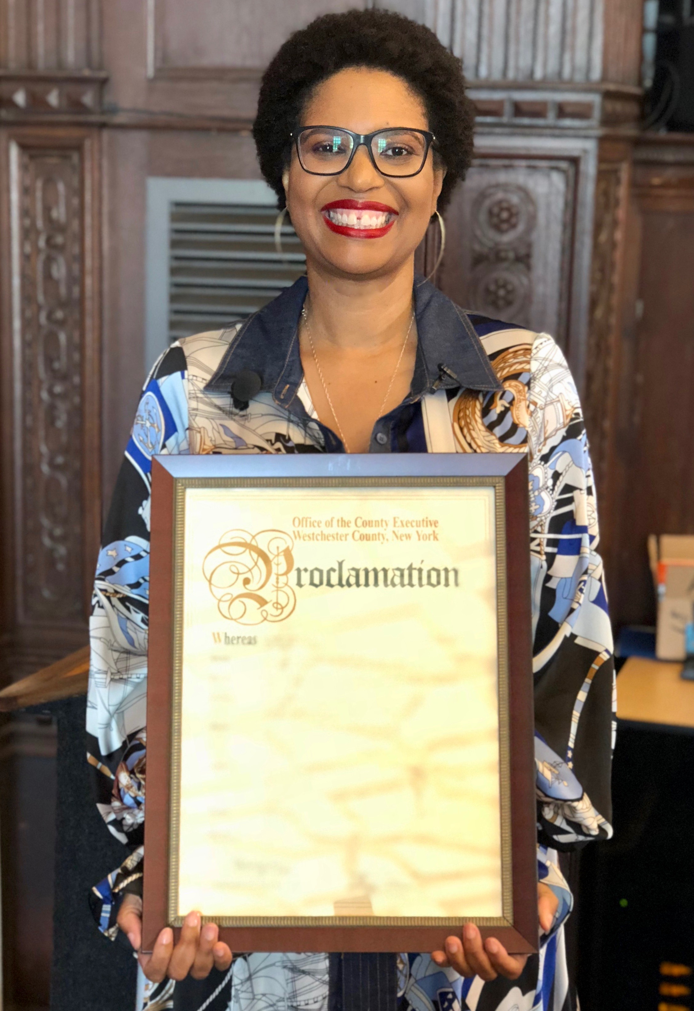 She Roars Founder, Vanessa Wakeman, receiving a Proclamation from the County Executive of Westchester, NY, in honor of her work on behalf of creating more female thought leaders.
