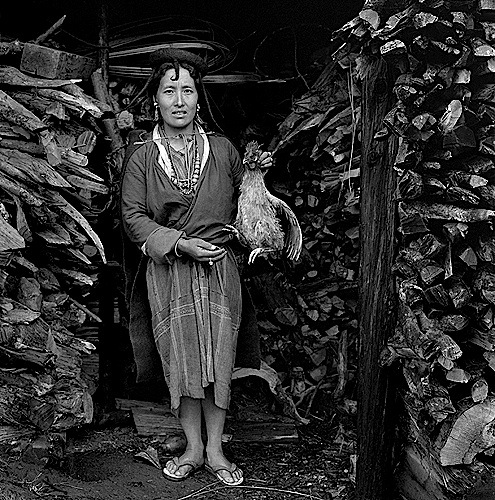 Dorji Dema and her hen in Merak village, 2001-2006