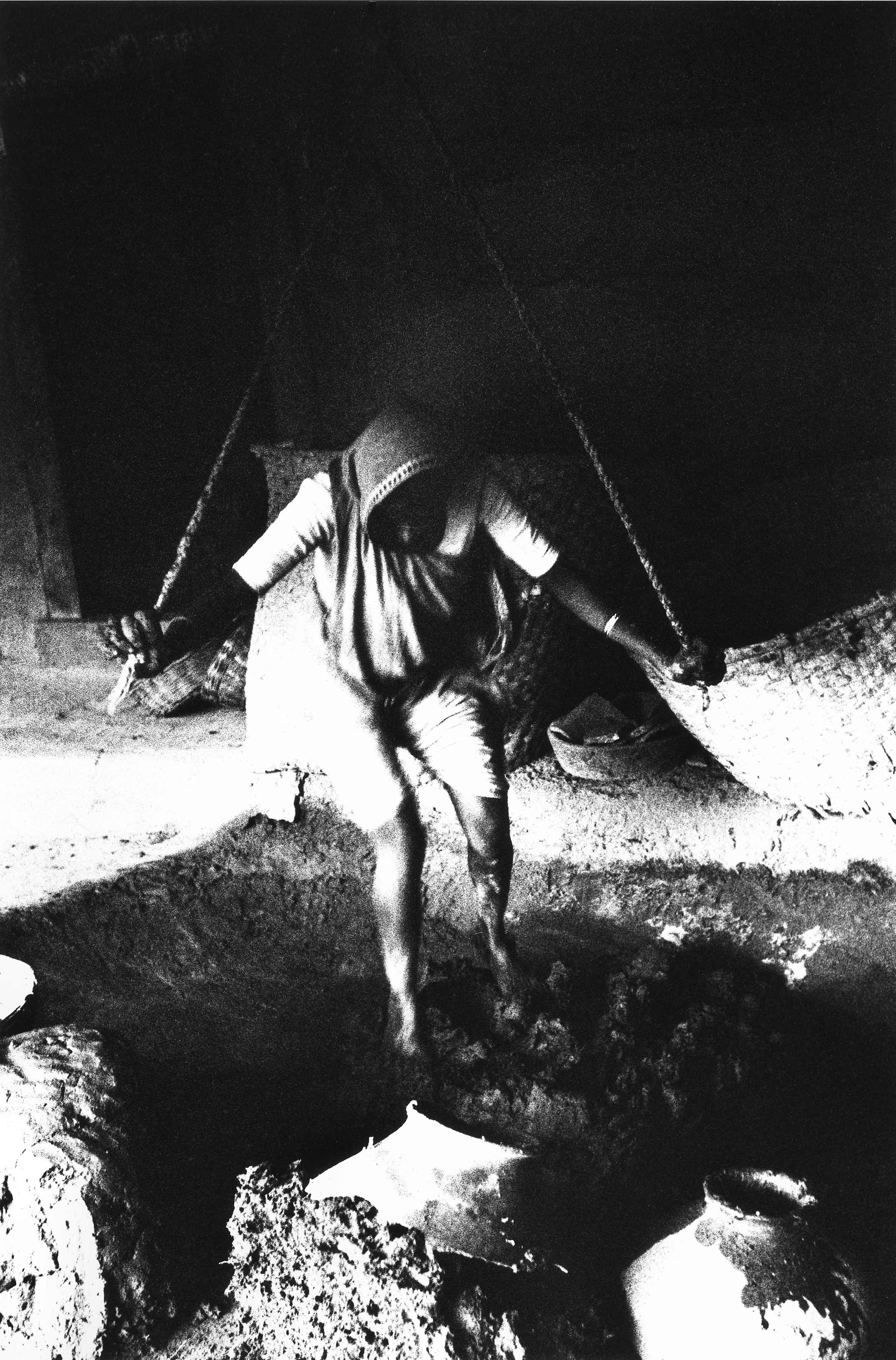 Bhupendra Karia, Woman massaging clay for rolling large pots,Potter's Village, Junagadh , 1967