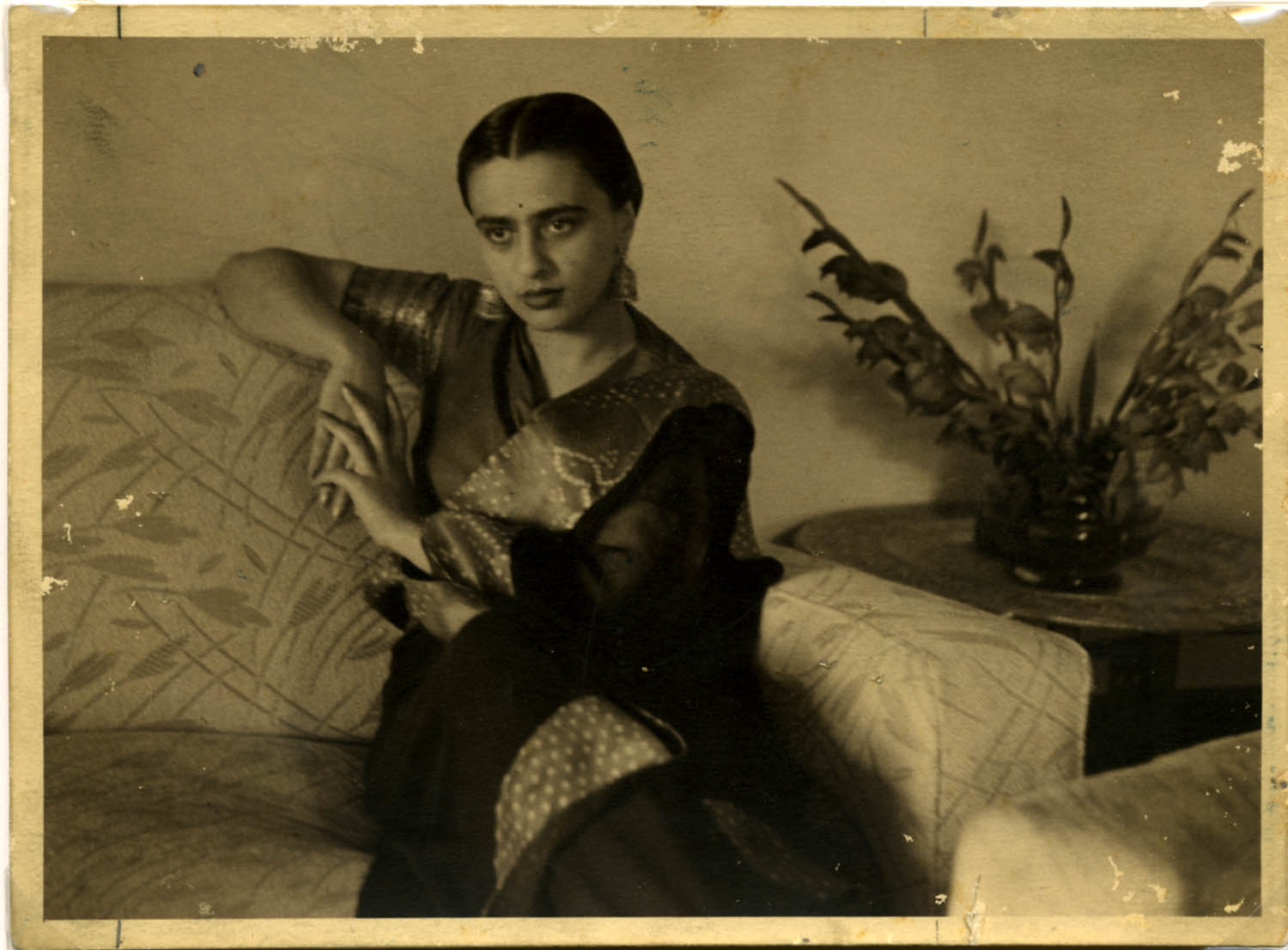 Umrao Sher-Gil,  Amrita seated in sari on couch,  1941. Courtesy of the Umrao Sher Gil Estate.
