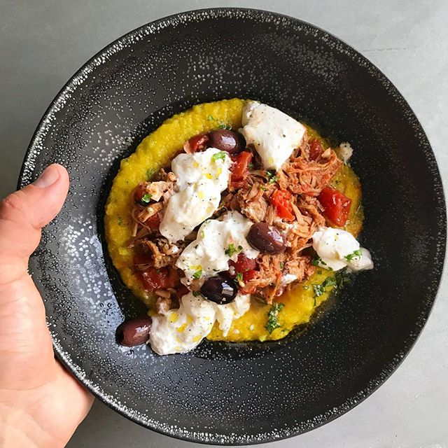 Hearty bowl of pork ragout on polenta with olives and burrata cheese #privatechef #holidaycooking #comfortfood #italianfood #italiancooking #instafood #instayum #instagood