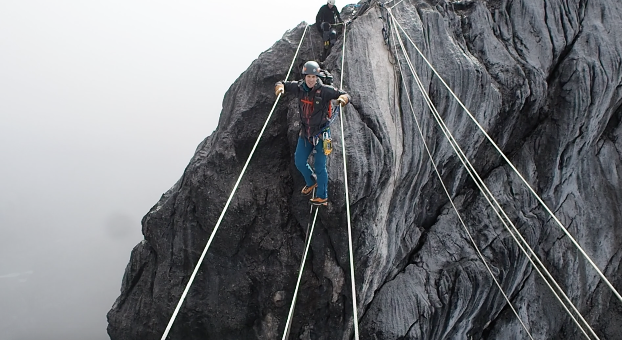2,000 feet of exposure at the tyrolean traverse on Carstensz Pyramid.