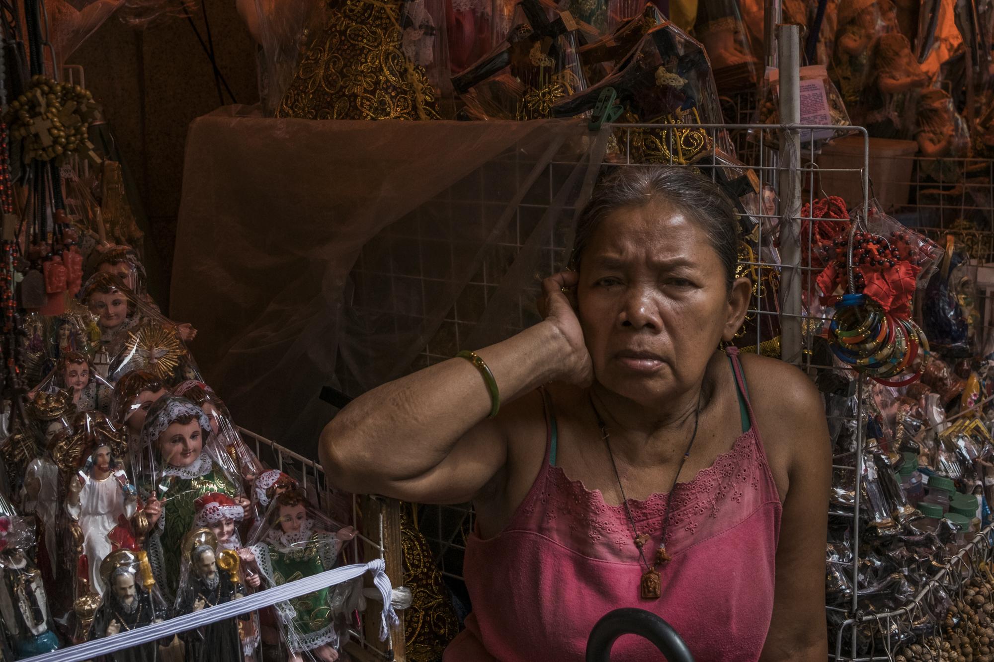 Woman with Sto. Niños   Gio Panlilio, 2017