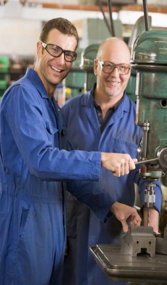 Workmen wearing safety glasses