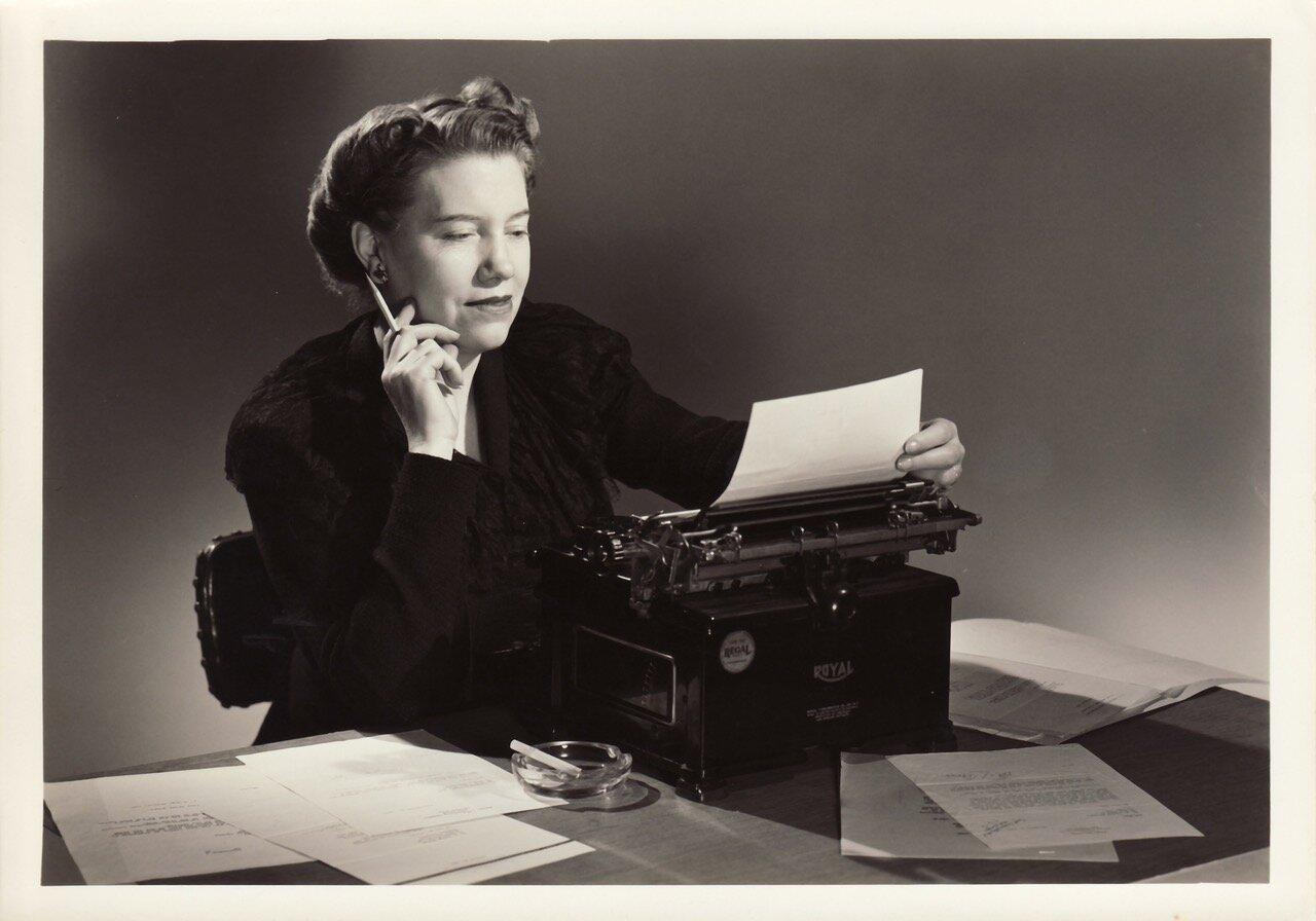 Nell at work on her typewriter.