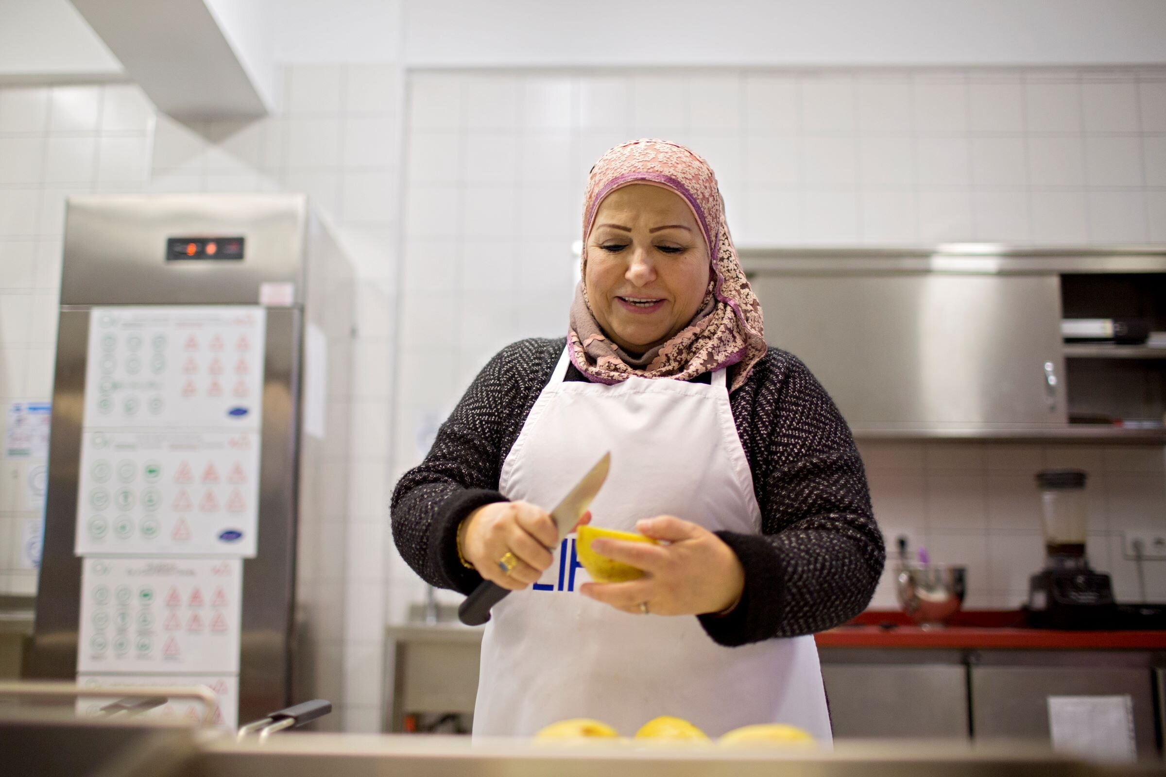 Sawsan prepares Safarjaliyeh,  quince and lamb stew , featured in the Cuisine of LIFE cookbook