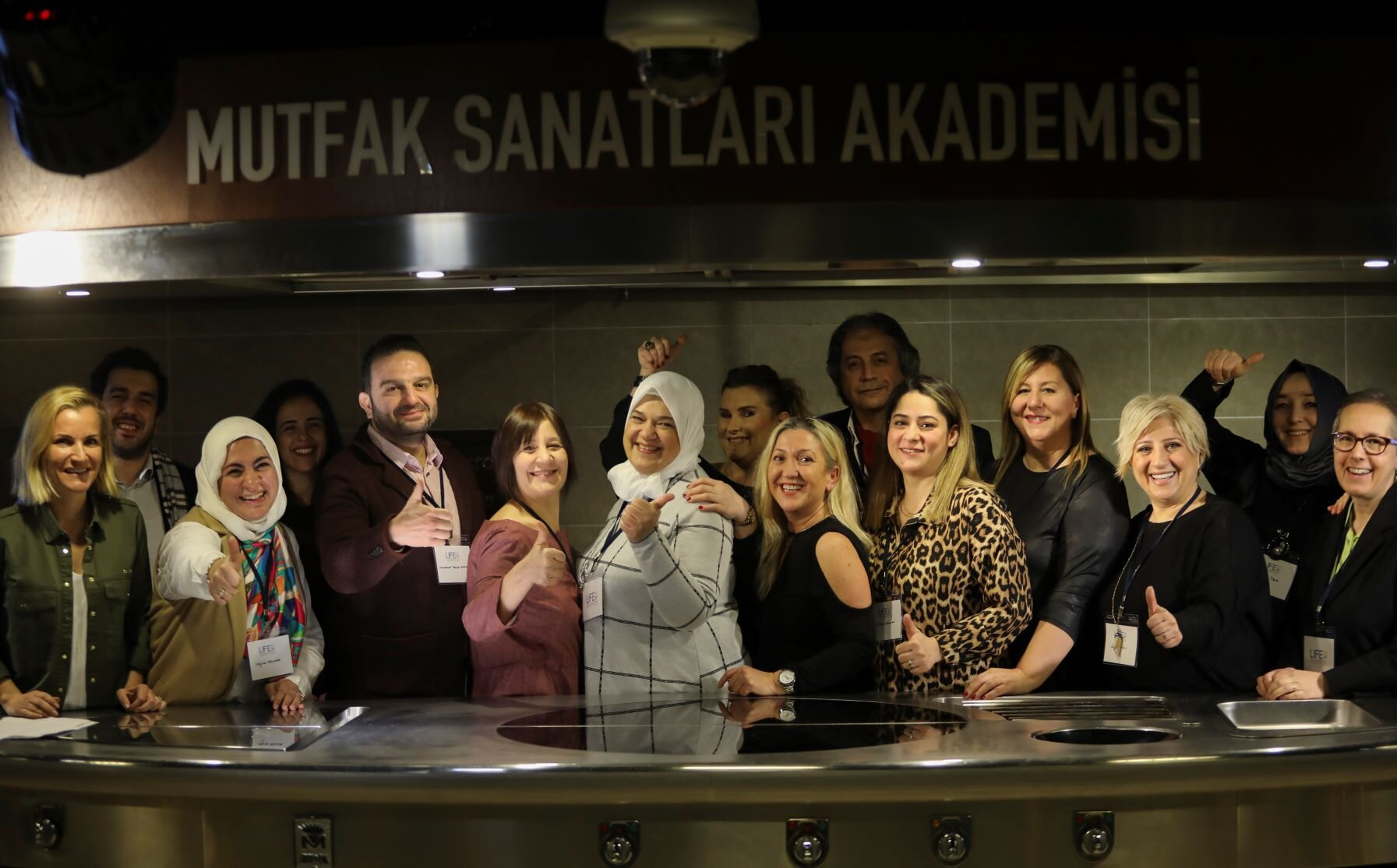 Contributing members celebrate their hard work at the cookbook launch event at MSA Istanbul