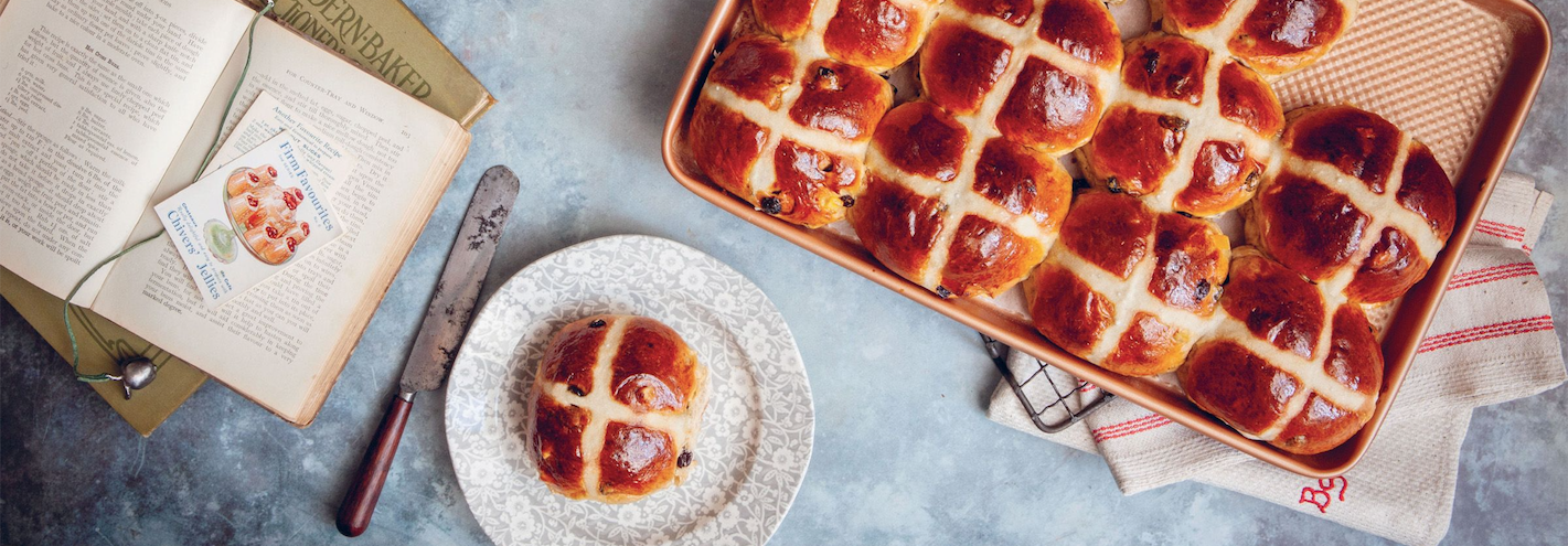 Hot cross buns, with single bun on a plate