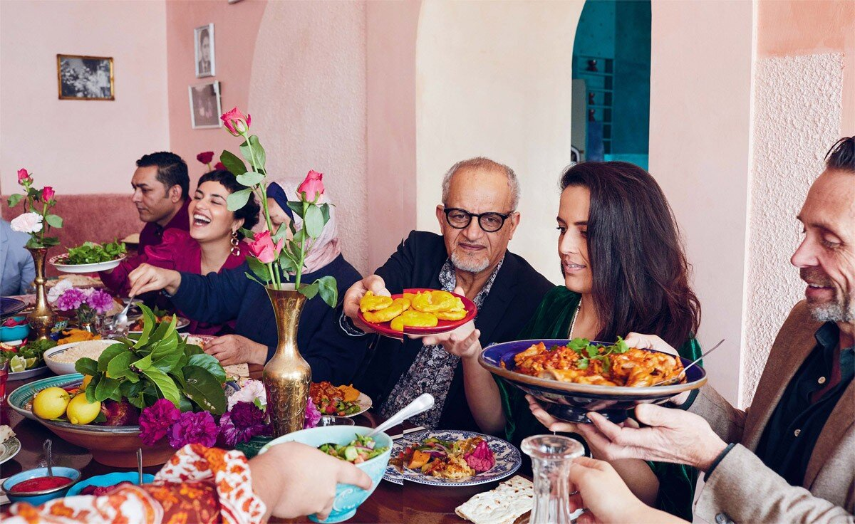 The Ayubi family enjoying a multi-generational meal.