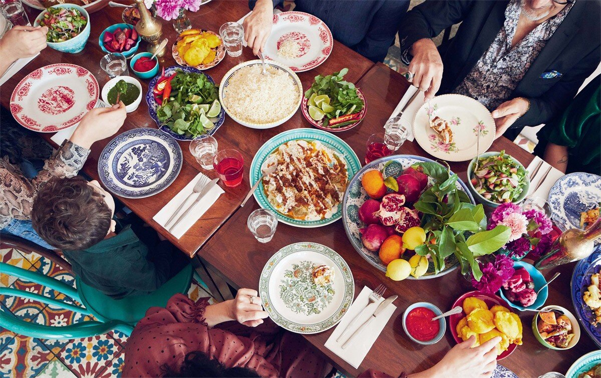 Afghan food is is served generously, piled copiously onto large platters for people to help themselves.