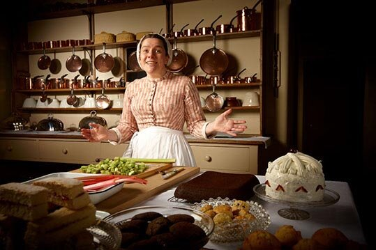 Dr Annie Gray, in character, at the kitchen at Audley End House.