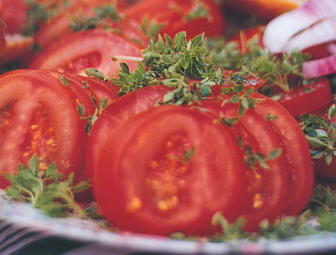 Ripe Marmande tomatoes, straight from the market to the plate.