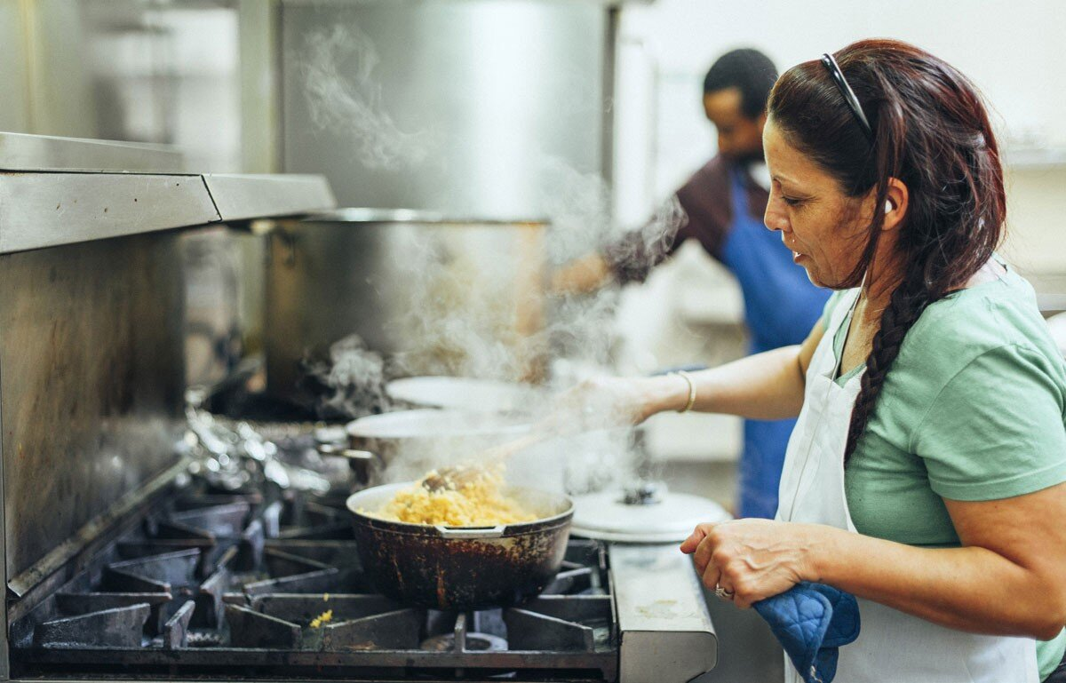 """""""La Cocina a place of work and stories, a warm and fragrant hearth where women (and some men) prepare food from their countries of origin and share their lives."""""""