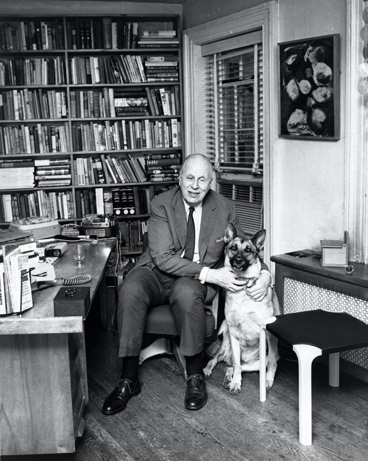 De Groot in the study of his Bleeker Gardens apartment c.1973, accompanied by his seeing-eye dog, Otona, and showing his dictation equipment. (Photo: Fiona Rhodes.)