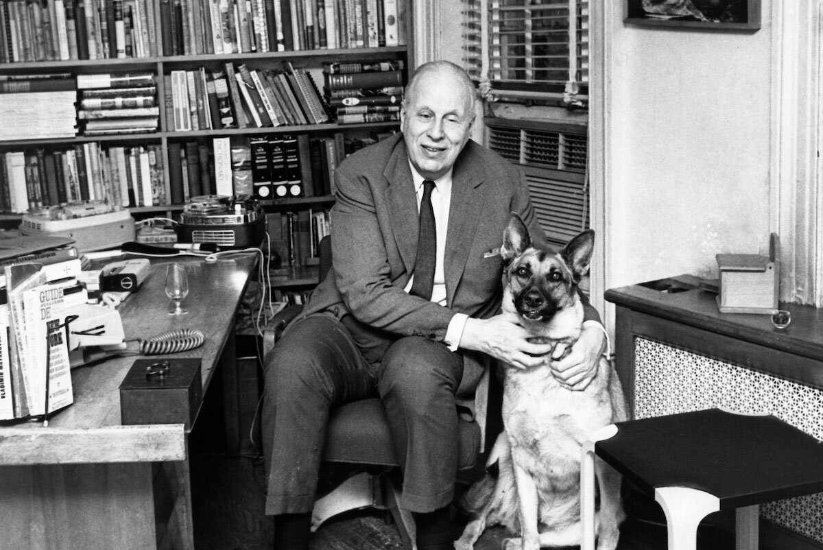 Roy Andries de Groot in his study with his seeing eye dog