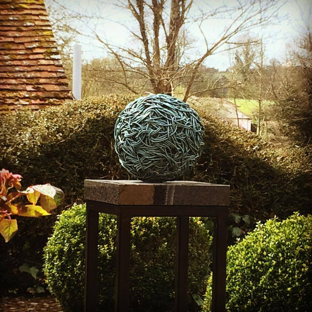 One of two Bronze Sphere Sculptures in situ ready for the exhibition at the Garden Gallery opens 14th May #art #sculpture #gardengallery #garden #weaving #bronze #lostwax