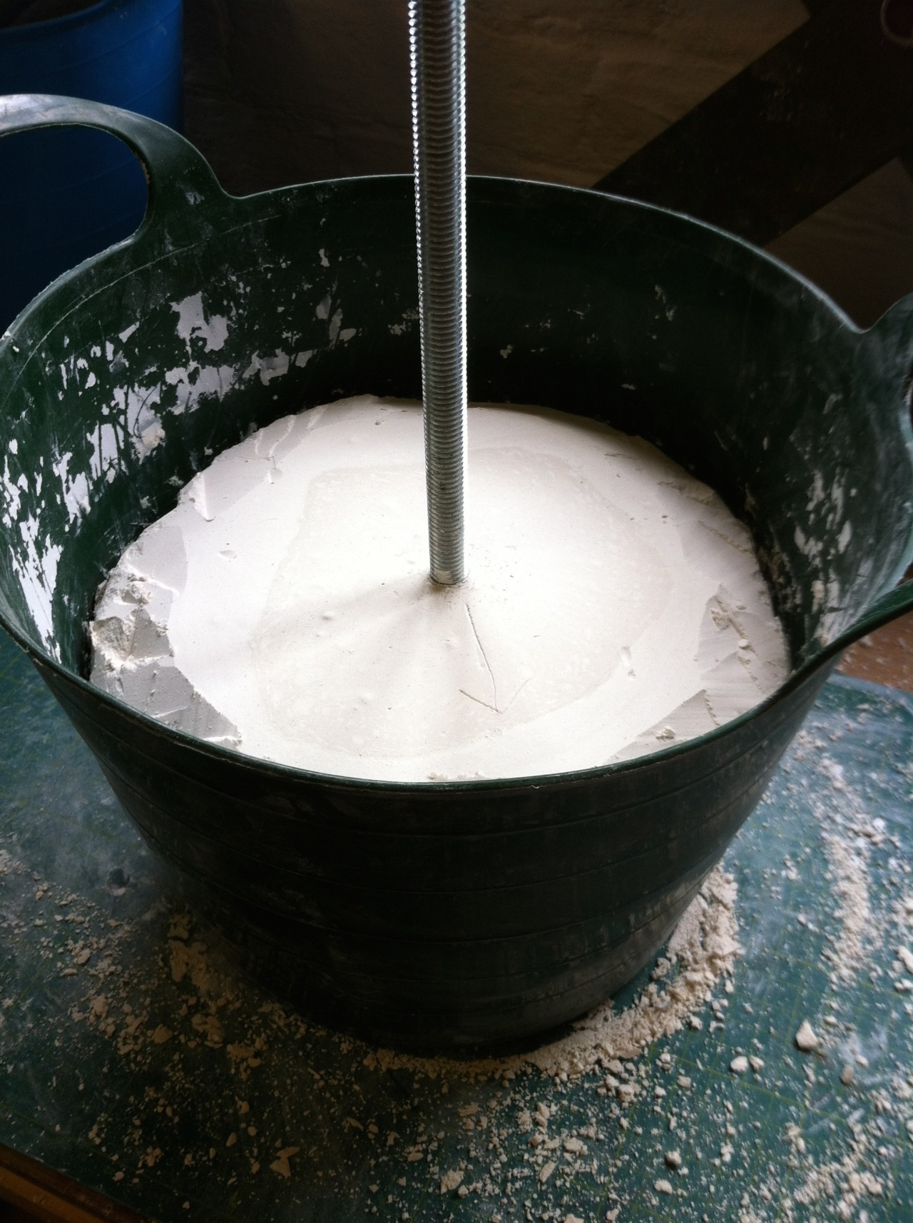 The stuck plaster block, part of my failed experiment to cast investment plaster in a rubber bucket.