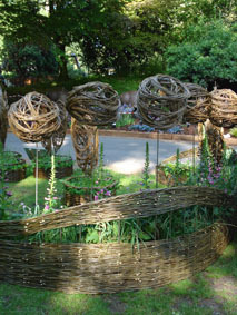 The willow spheres in the large sculptural raised beds