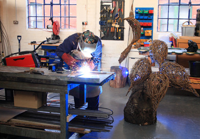 Welding my frames for the Chelsea Flower show sculptures, photography by Chris Hardy