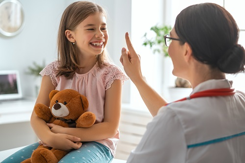 doctor-examining-a-child-ALC6UDS.jpg