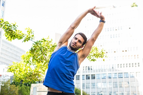 handsome-athlete-stretching-in-the-city-PTBB8E6.jpg