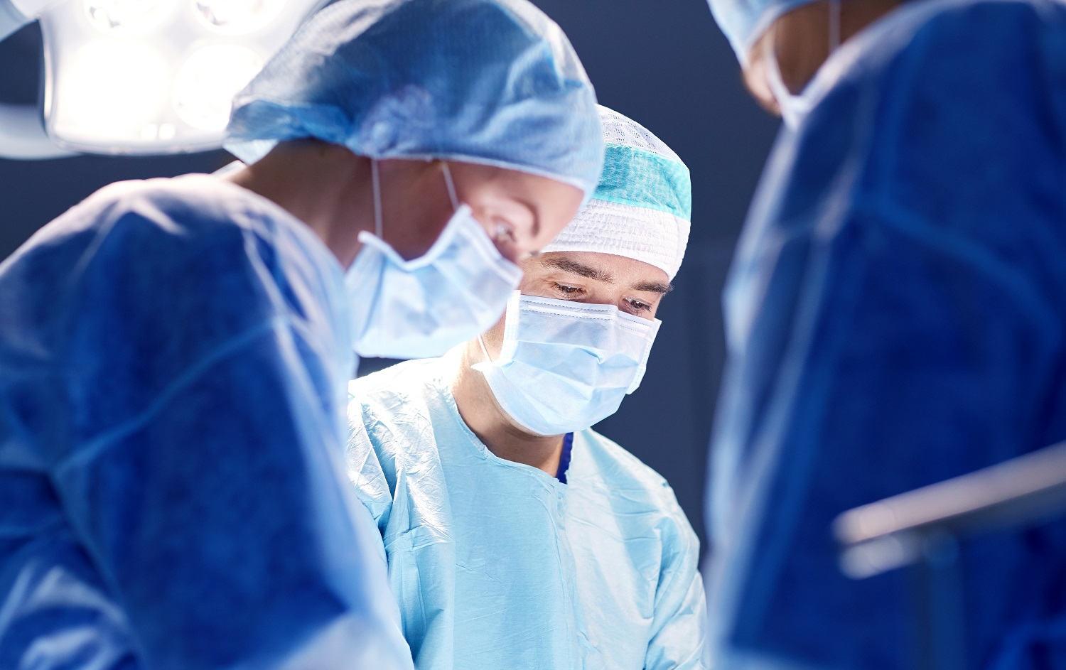 group-of-surgeons-in-operating-room-at-hospital-P5Q2EH6.jpg