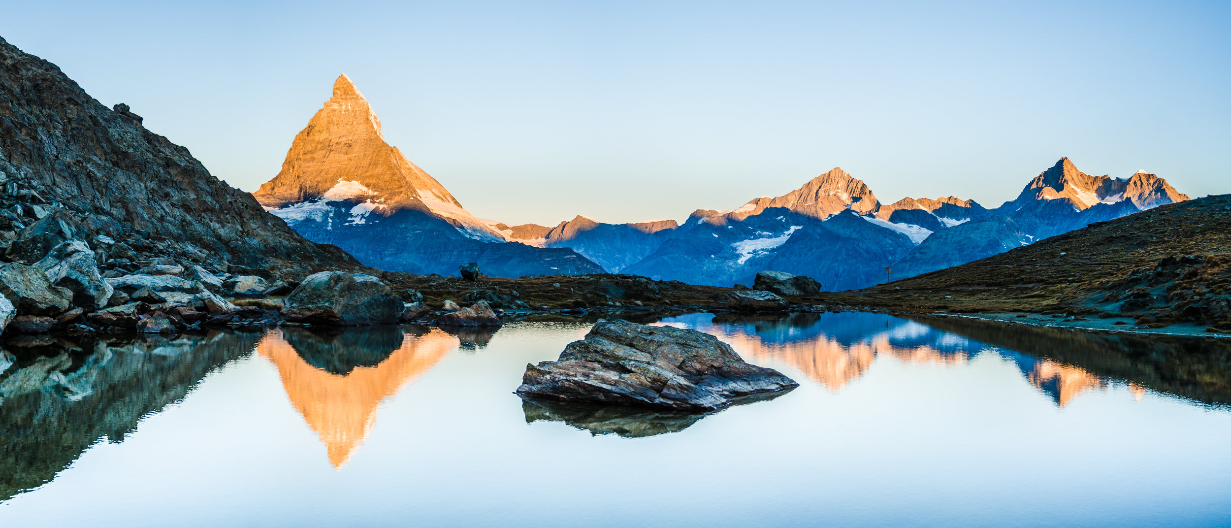 The Matterhorn reflected in the cool waters at Riffelsee Lake.