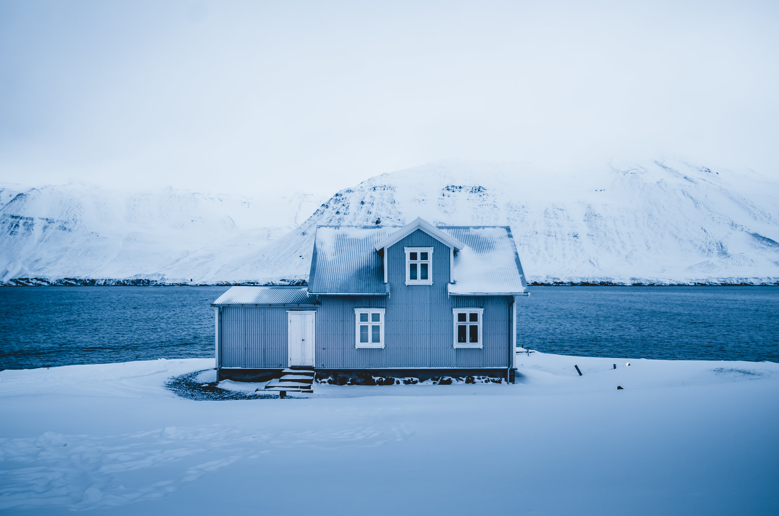Photo of a house during the winter months in Iceland, photographed using a landscape (horizontal) photo composition.