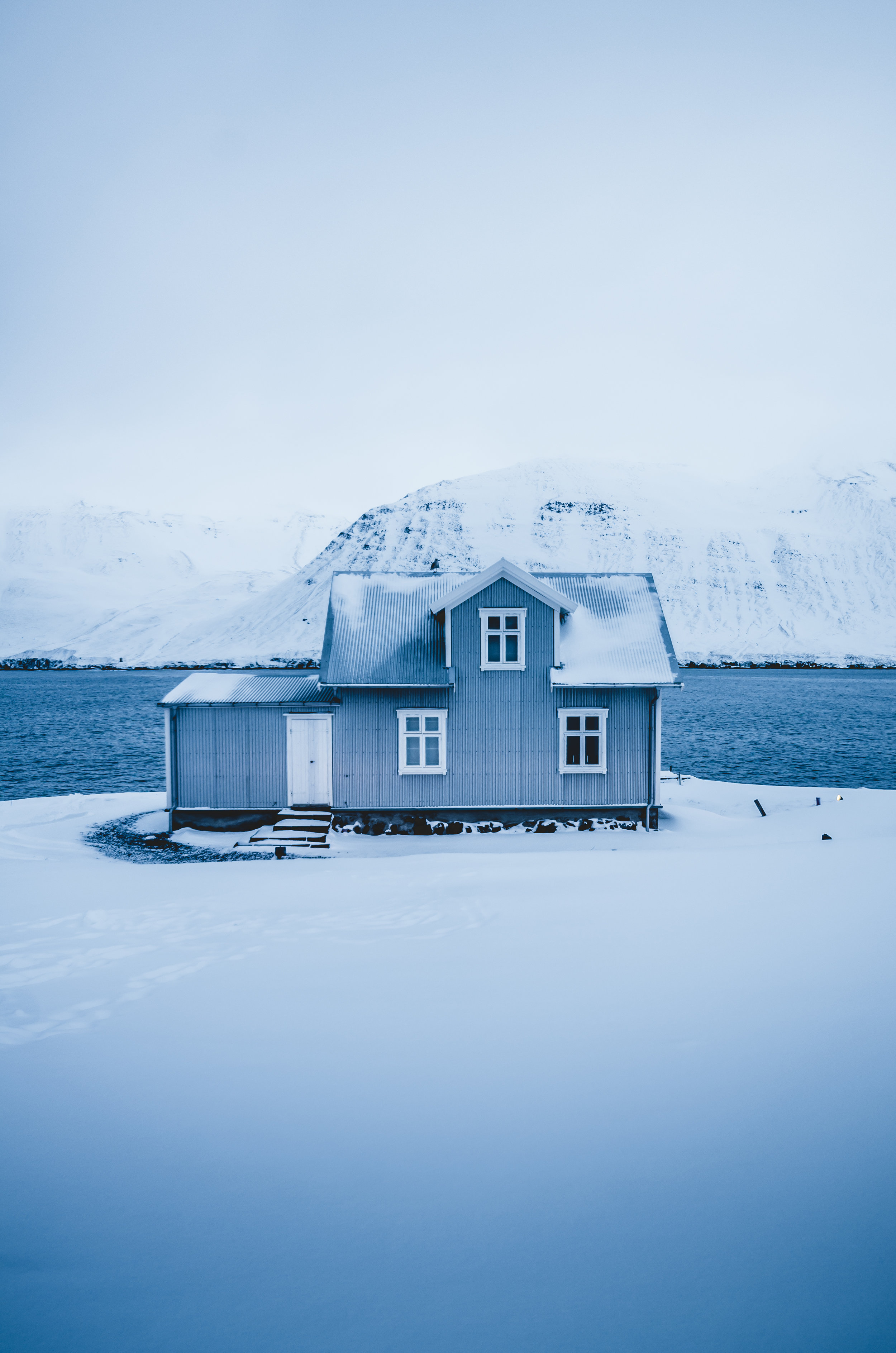 Photo of a house during the winter months in Iceland, photographed using a portrait (vertical) photo composition.