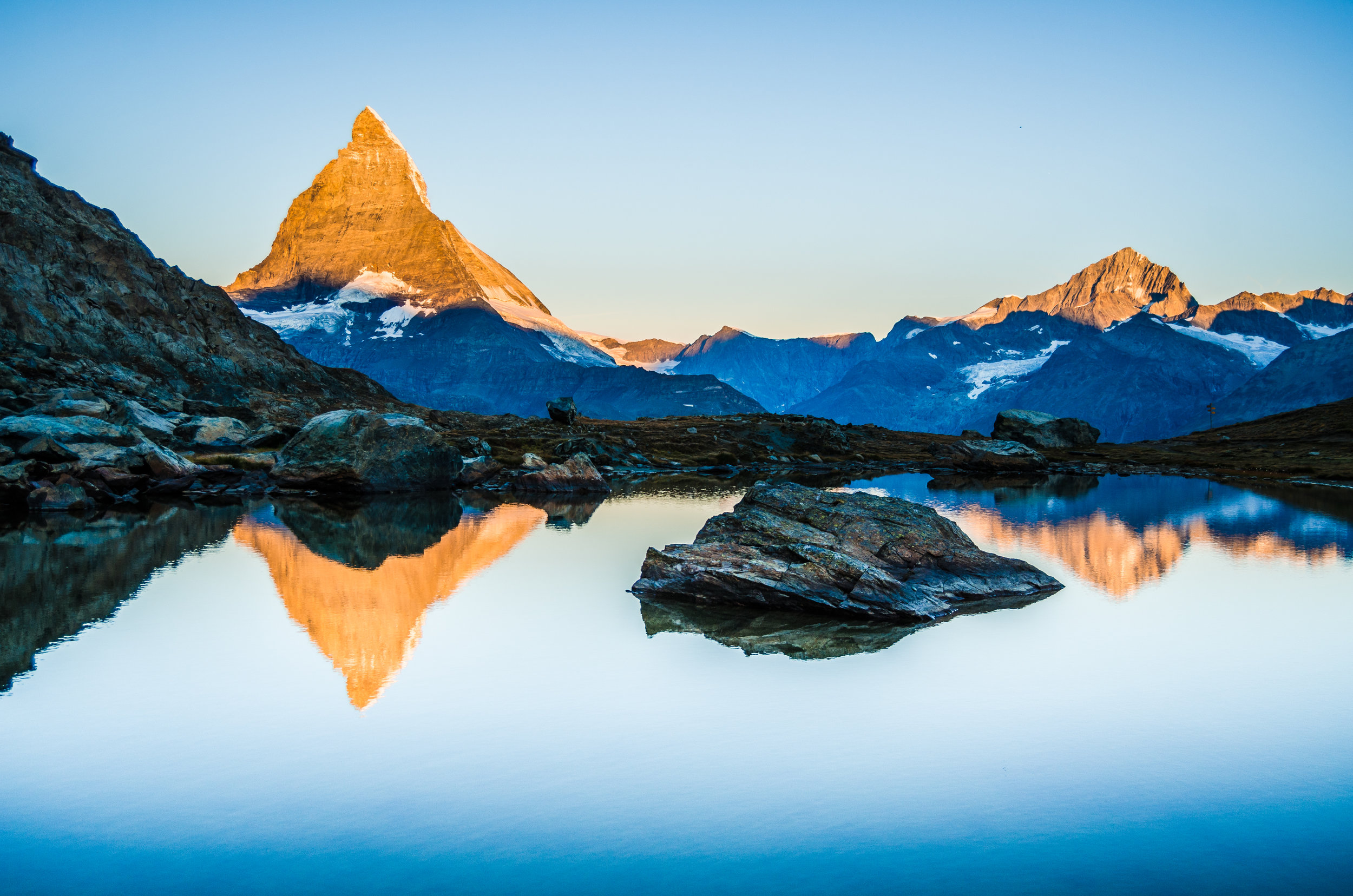sunrise-lake-reflection-summer-matterhorn-switzerland.jpg