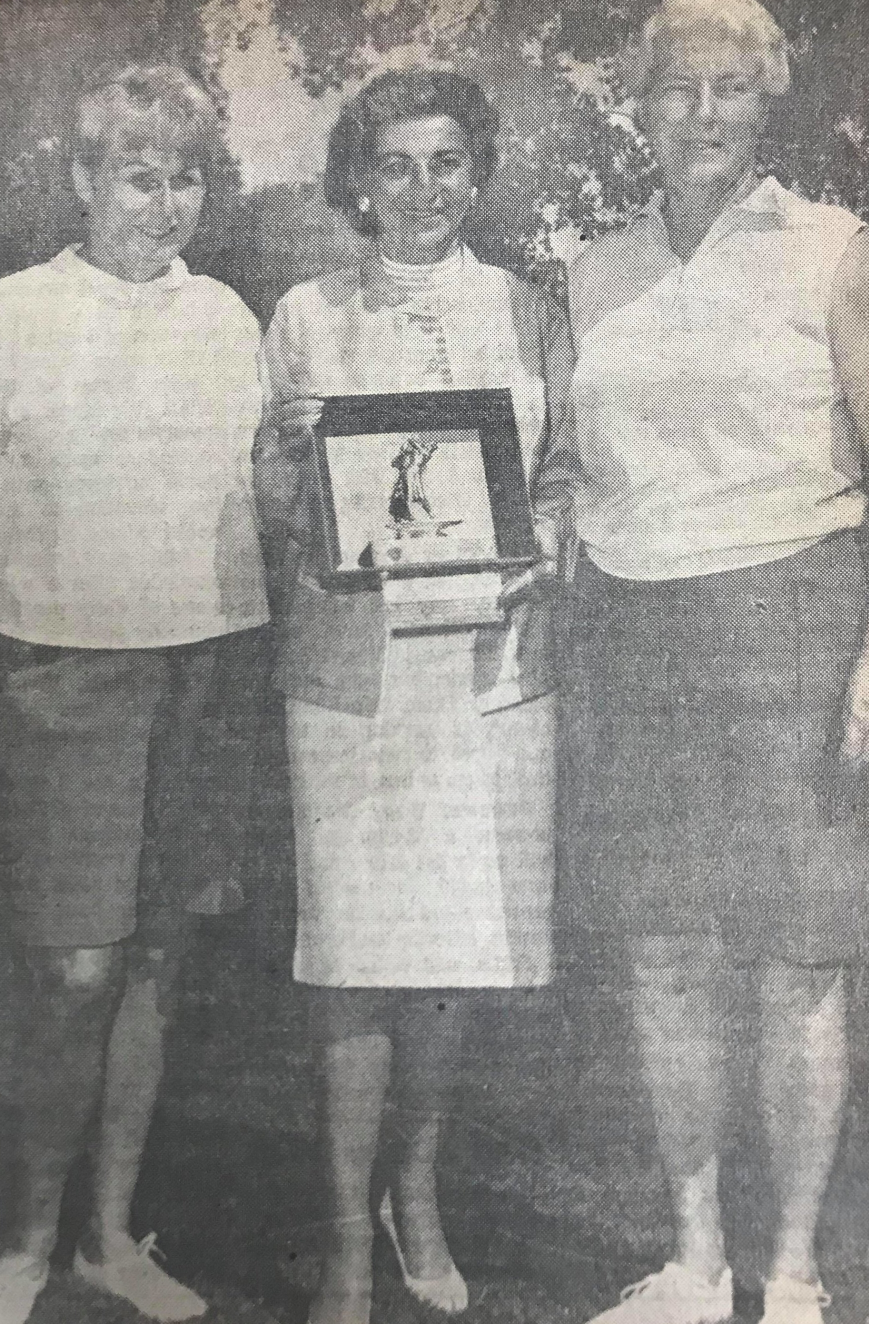 Mrs. Clinton Adams of Sacramento, at left; and Mildred Jude of Berkeley, at right; receive runner-up and winner's awards from Mrs. P. K. Maxey, Pacific Women's Golf Association president, following the state championship tournament of the Whitney Ranch National course at Rocklin. Miss Jude defeated Mrs. Adams 4 and 2 in the final round.