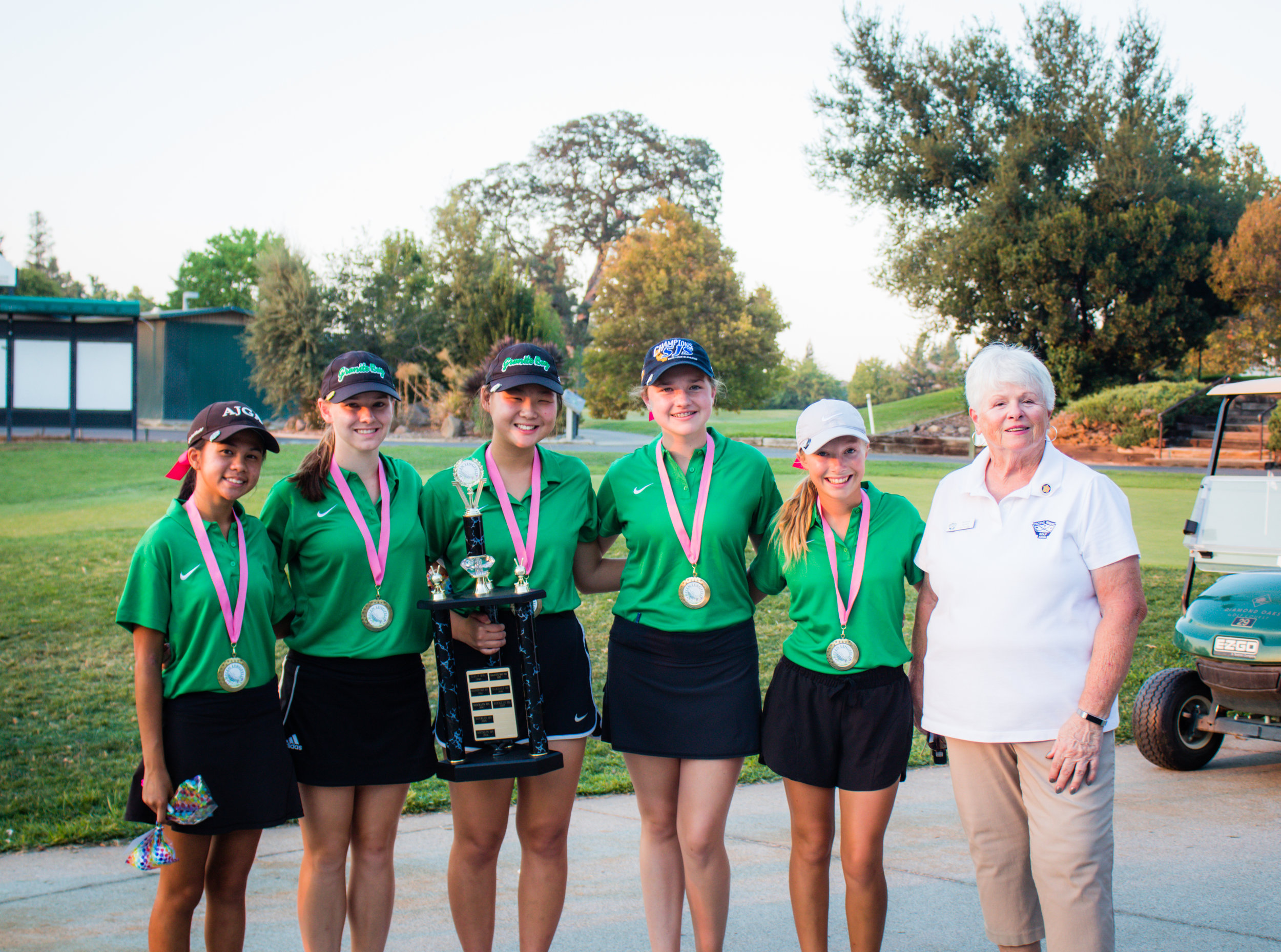 Granite Bay High School golfers, along with PWGA Vice President, Sue Kort.