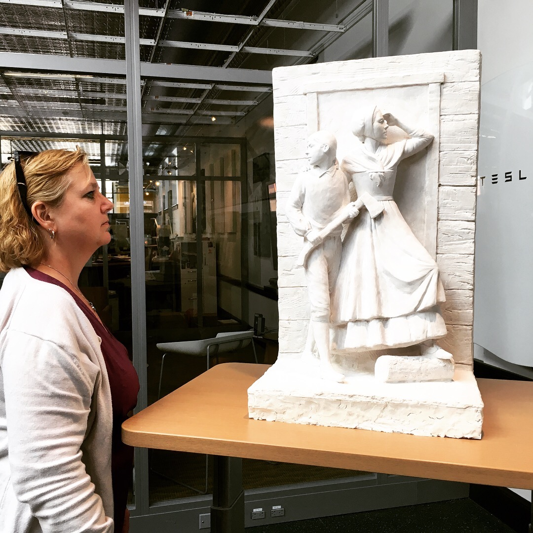 A woman views the maquette at the Energy Innovation Center in Downtown Rutland, Vermont on May 18th, 2018.