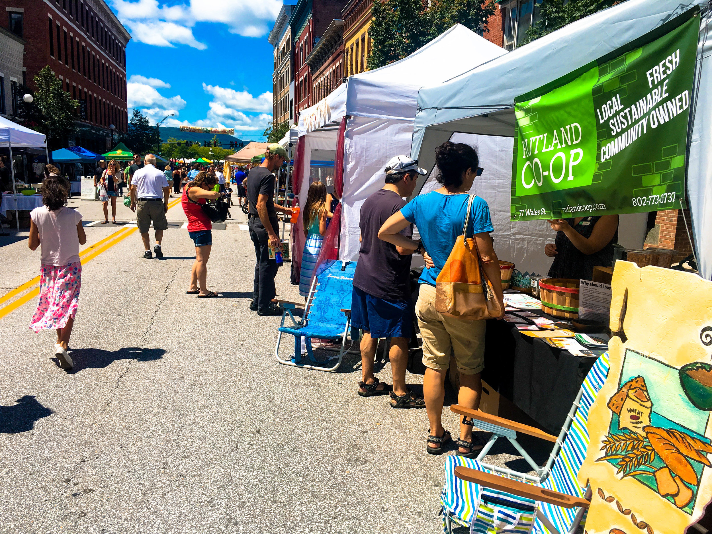 Attendees browse vendor tents at the Downtown Rutland Street Party & Sidewalk Sales.