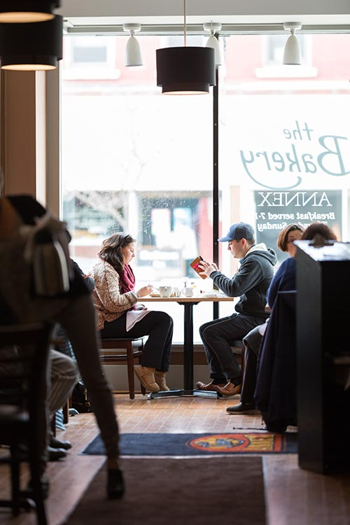 A couple enjoys coffee and brunch at The Bakery Annex.